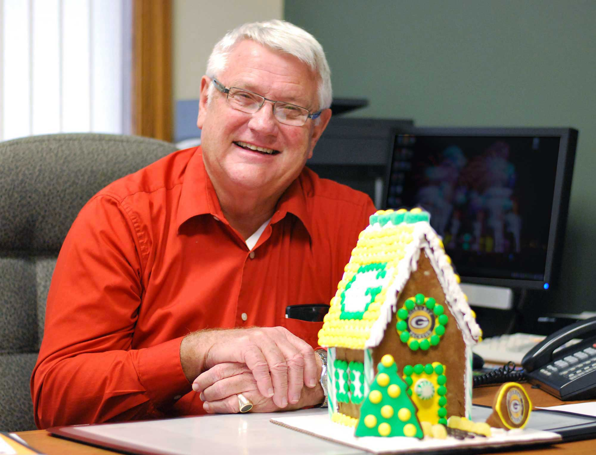 Howard Wiedenhoeft crafts gingerbread houses with detail and love.