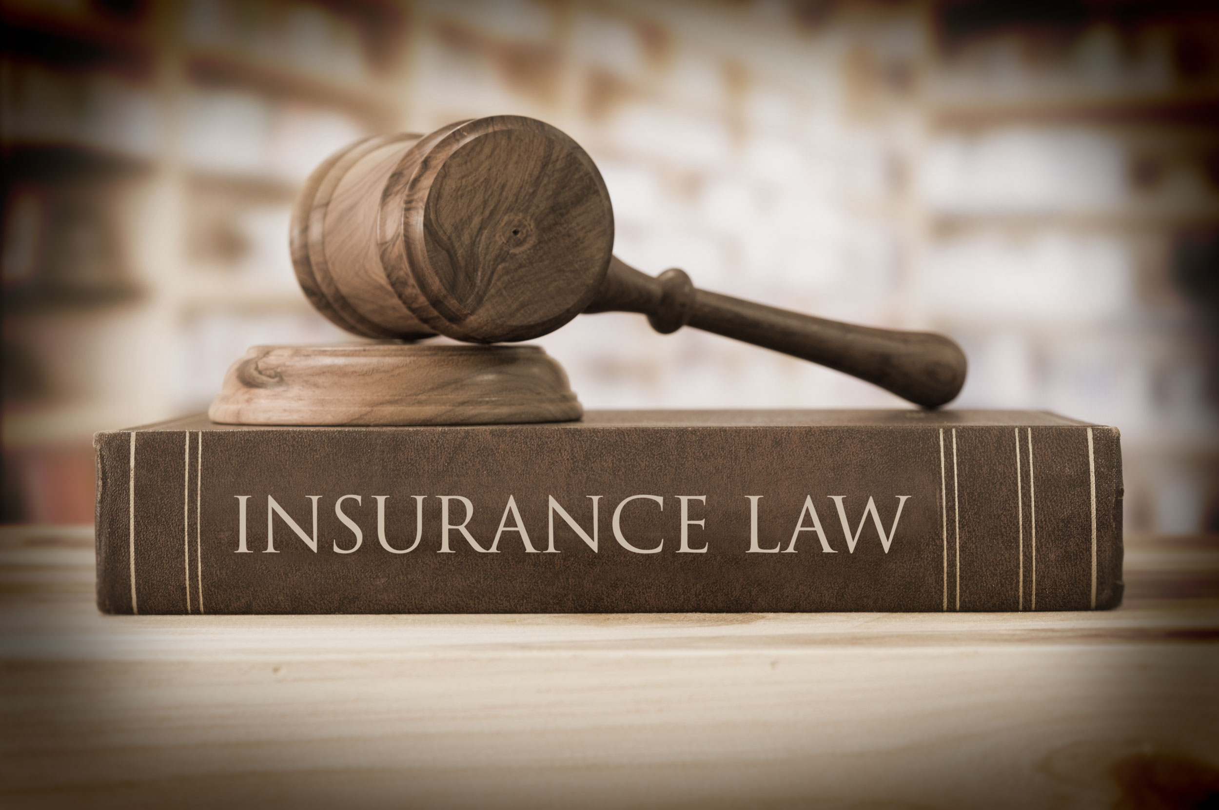 Insurance Law books and gavel